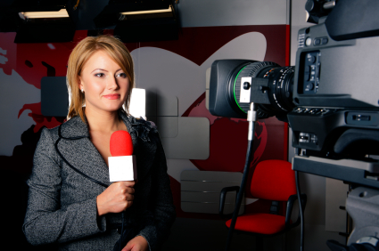 attractive television news reporter and video camera