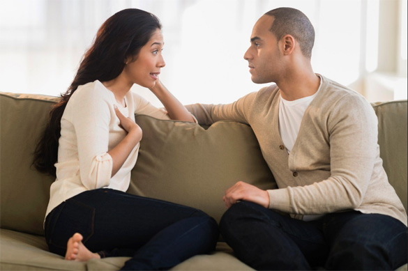 couple-having-conversation-in-the-living-room